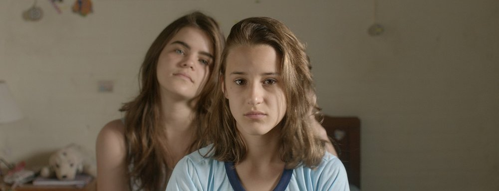 TWO IRENES / AS DUAS IRENES  (Fabio Meira, Brazil, 2017, 89 min. In Portuguese with English subtitles)   Q&A with director Fabio Meira   By chance, Brazilian teenager Irene (newcomer Priscila Bittencourt, in an assured performance) discovers that there is another 13-year-old Irene living in the same town. Curiously, she observes the confident, cheerful girl who lives alone with her mother. She is fascinated by this other world beyond the bounds of her own well-to-do and traditional family. This other Irene seems free. Soon the two girls, apparently so different from each other, are spending every day together, meeting up with boys in the cinema or going to the lake. When they start talking about their fathers, they notice that they have more in common than they had thought. Winner of the Best First Feature and Best Cinematography awards at the Guadalajara Film Festival, this debut feature by Fabio Meira is an exquisite mosaic that weaves a wonderfully delicate web around questions of identity, true friendship, and the first steps towards adulthood.   Monday, November 5, 7:15pm