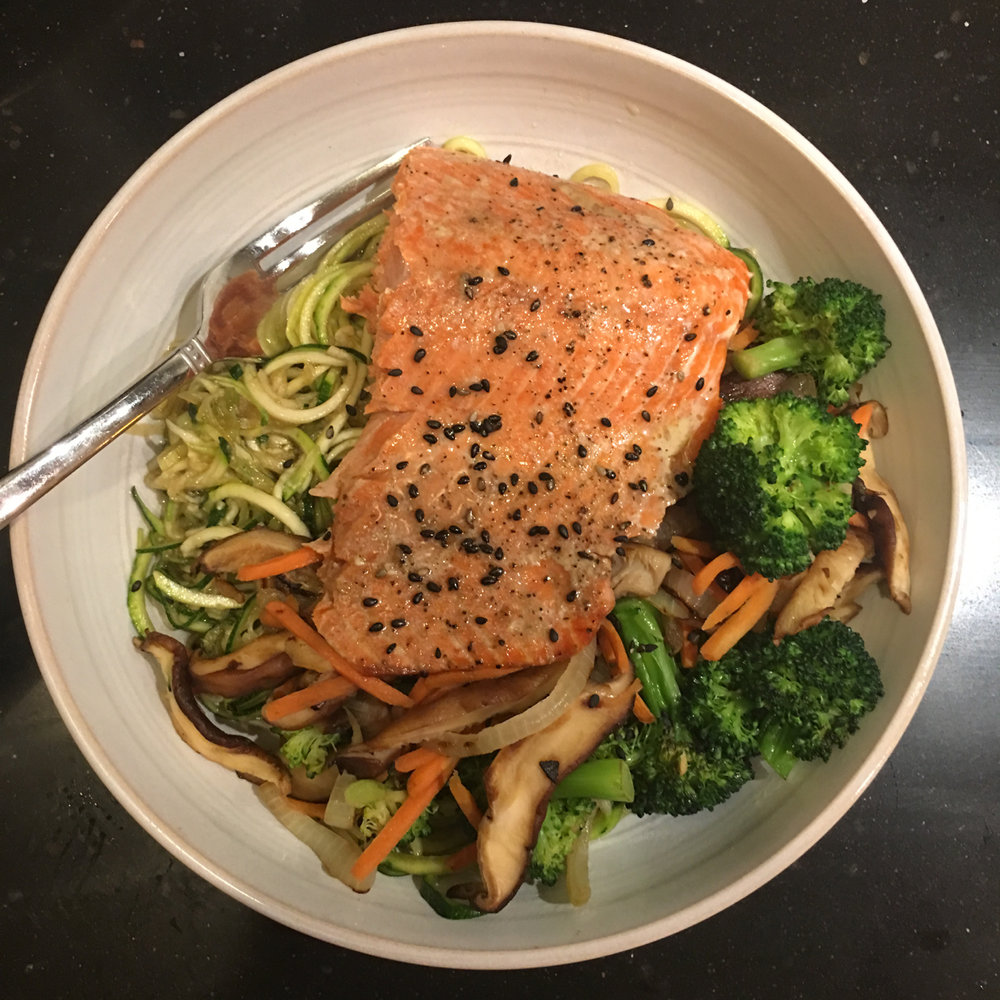 SOY SESAME SALMON WITH SAUTEED SHIITAKE MUSHROOMS, BROCCOLI, CARROTS, ONIONS, GARLIC AND ZUCCHINI NOODLES