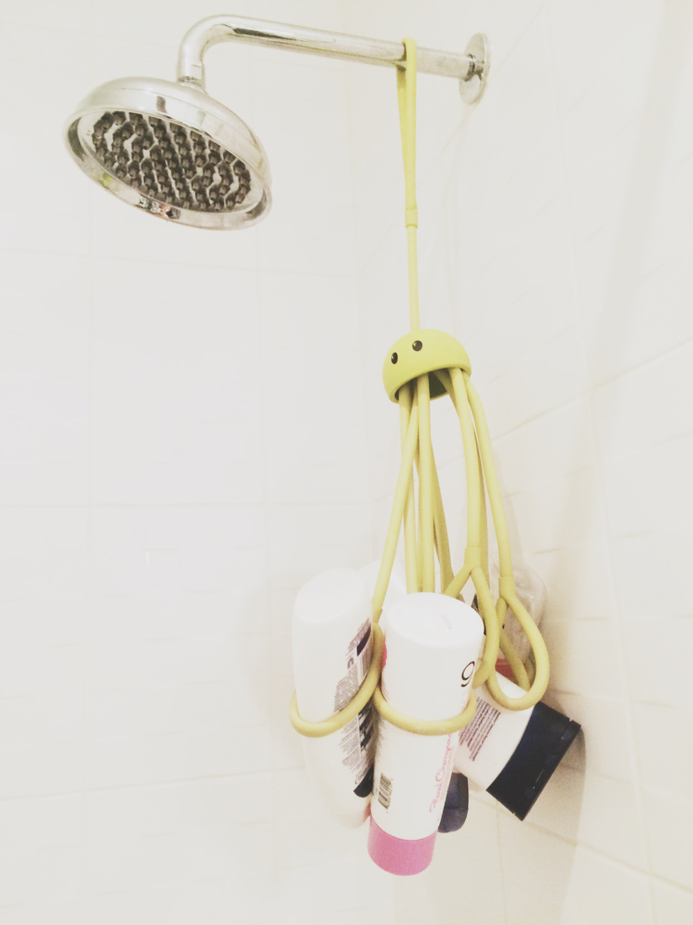 THE LITTLE THINGS   Have I mentioned that we live in a small space ;) ?  Well in a small space when every inch counts, the tiniest detail can make a big difference.  I picked up this octopus shower caddy (link  here ) at the  Dwell  design show on a whim a few years back and this playful addition has come in even more handy lately.  It keeps most of our bath products off the ledges which is helpful in keeping the ledges clear of clutter and leaves the shower/tub easy to clean.  The octopus also keeps bottles off the ledges which tend to be too tempting for a chubby fingers that love the crashing sound they make when they fall in the tub.   Clutter free surfaces in any home are a welcome site but in a small space they are a necessity and anything that easily accomplishes this feat like this Octupus shower caddy is a big win.  Now if only something some this simple could tackle the clutter on our entry bench…