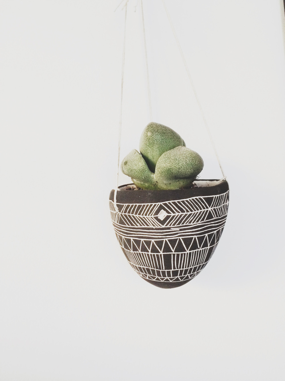 Planters that hang are the best! and cute to boot.  In a tiny space you really have to think about anything you add but this choice was an easy one.   Planter:  poppytalk  //