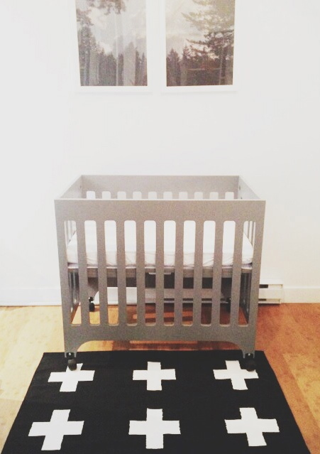 We decided on a mini crib for obvious size constraints.  The babyletto grayson was our pick.   The style is clean and simple and has proven to be quite sturdy. I had big dreams of turning one of our closets into a nursery until measurements proved that all our closets were too small (oh tiny living!).  One added benefit of a mini crib is it fits pack and play sheets which tend to be cheaper and take up less storage space.  I had visions of packing it away when not in use but turns out that is not something you have the time or energy to do when a new baby takes all your time (seriously the days fly by with no tangible tasks completed).   crib:  babyletto  (similar) // rug:  pattern society  // art:  blue window creative