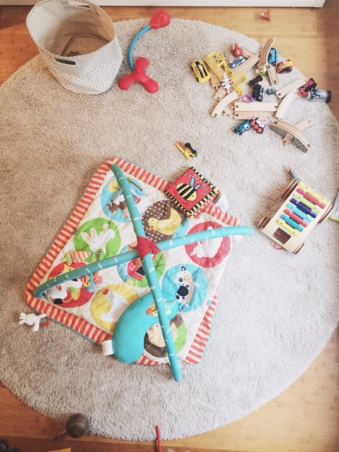 Baby and Toy explosion in our living room
