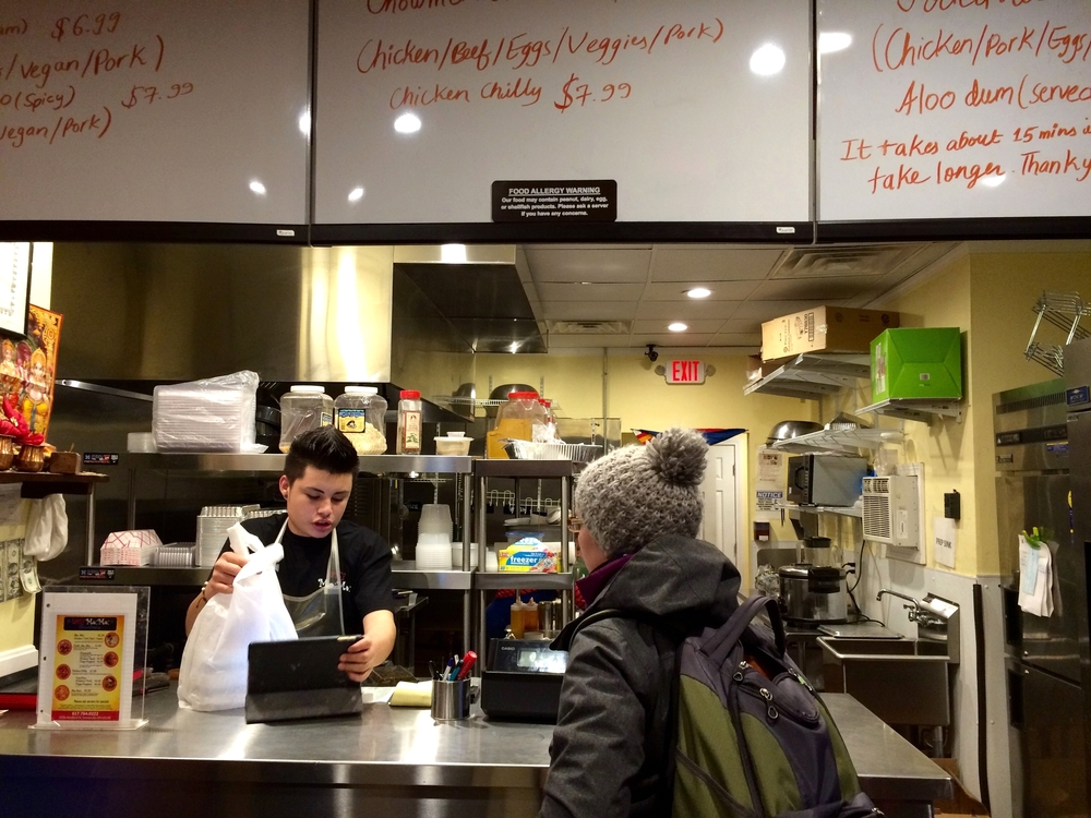 The front counter and kitchen at Tasty Mo:Mo in Somerville, MA.