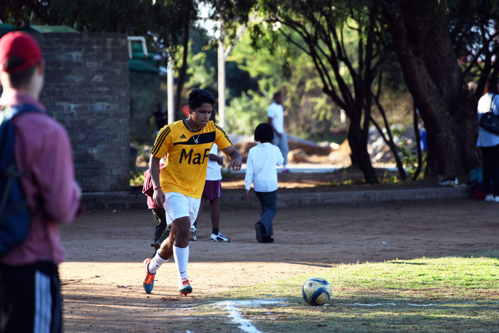 Harsh, one of the Harvards, takes a corner kick at the MaP Under 19 soccer game today.