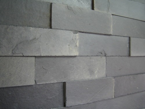 24. Grey slate flagging to be used for cladding. Thickness about 20mm, height 80mm random length. Easy to glue over wall surface to achieve stone wall like effect. Perfect for amateur renovator