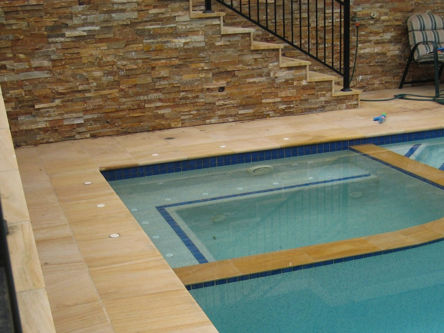 43. Woodgrain sandstone pool with stackerstone walls. Photo taken 5 years after laying the tiles
