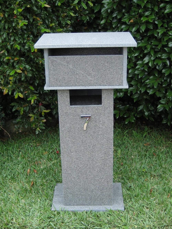 8. Blue stone letterbox with bushhammered finish. Back 2 key aluminium door. Tough material. Sizes 820x400x300 $525