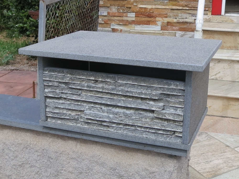 24. Blue stone Letterbox top only ready to sit on pier or front fence or wall. Aluminium door with 2 keys large enough to fit A4 size magazines. 300x400mm and approximately 200mm high. $240