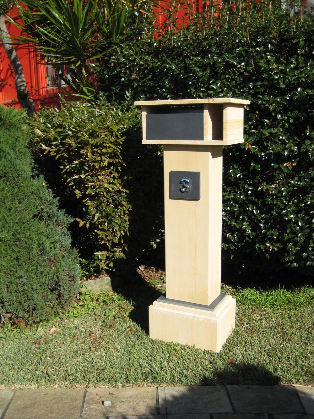 46. Extra tall letterbox, woodgrain sandstone. 1060 tall, dimensions 1250x500x300 $750