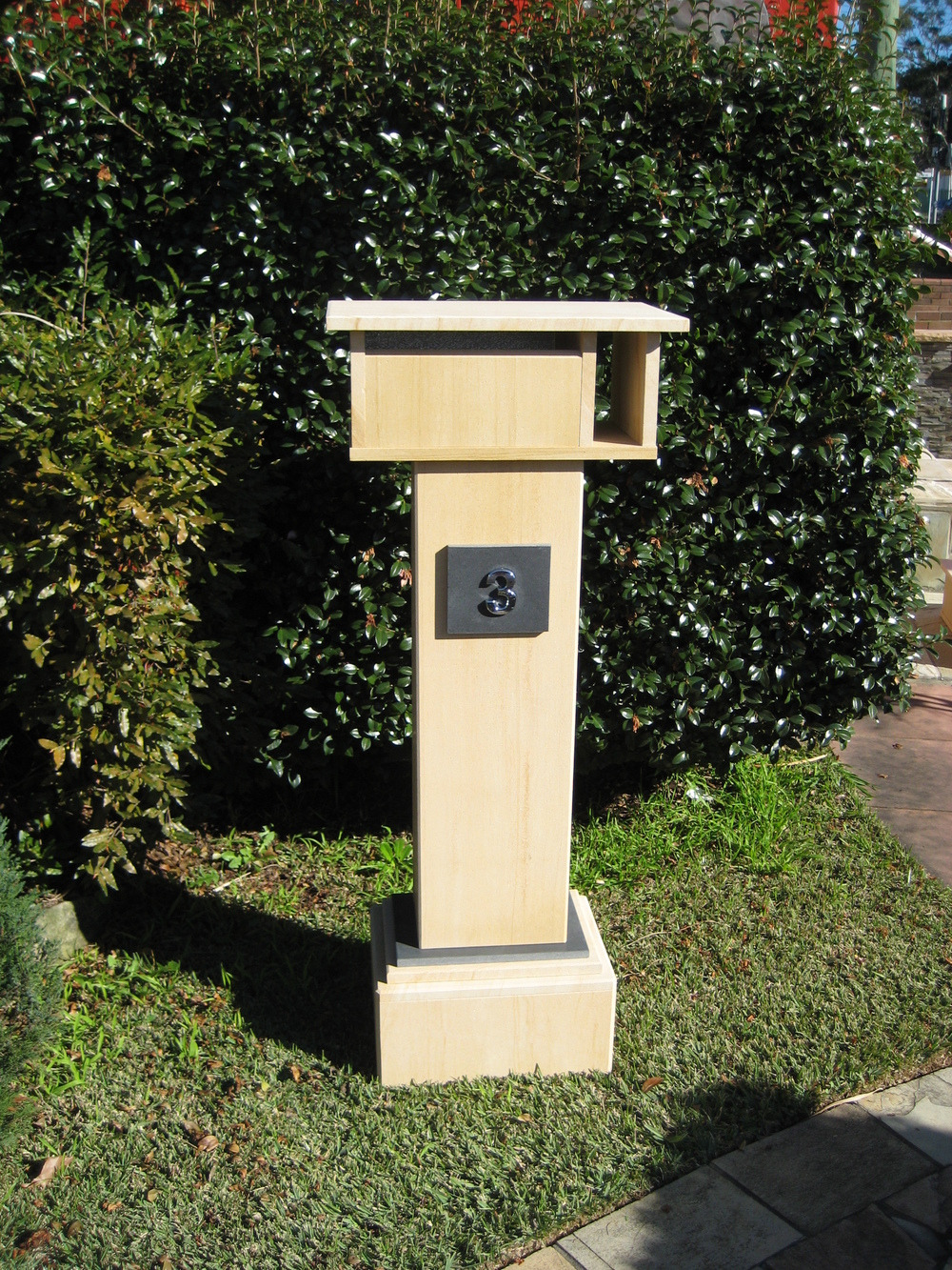 47. Extra tall letterbox, woodgrain sandstone. 1060 tall, dimensions 1250x500x300 $750