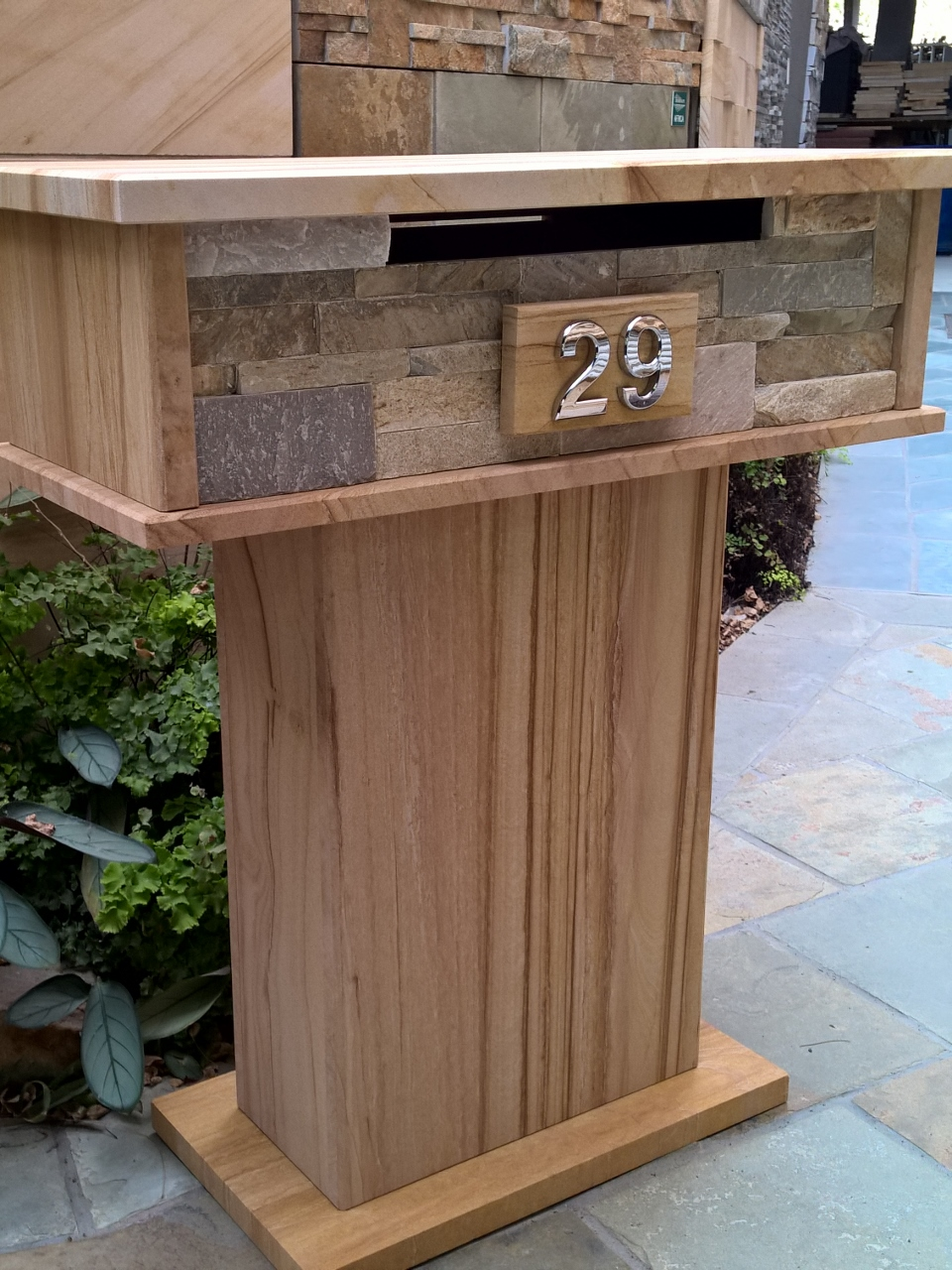 55. Extra wide sandstone letterbox with stackerstone front opening is wide enough to fit A4 magazines. Fitted with aluminium lock 2 key. Size 760x340 Hight 870mm $690