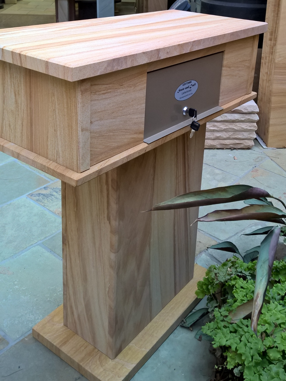 56. Extra wide sandstone letterbox with stackerstone front opening is wide enough to fit A4 magazines. Fitted with aluminium lock 2 key. Size 760x340 Hight 870mm detail from the back $790