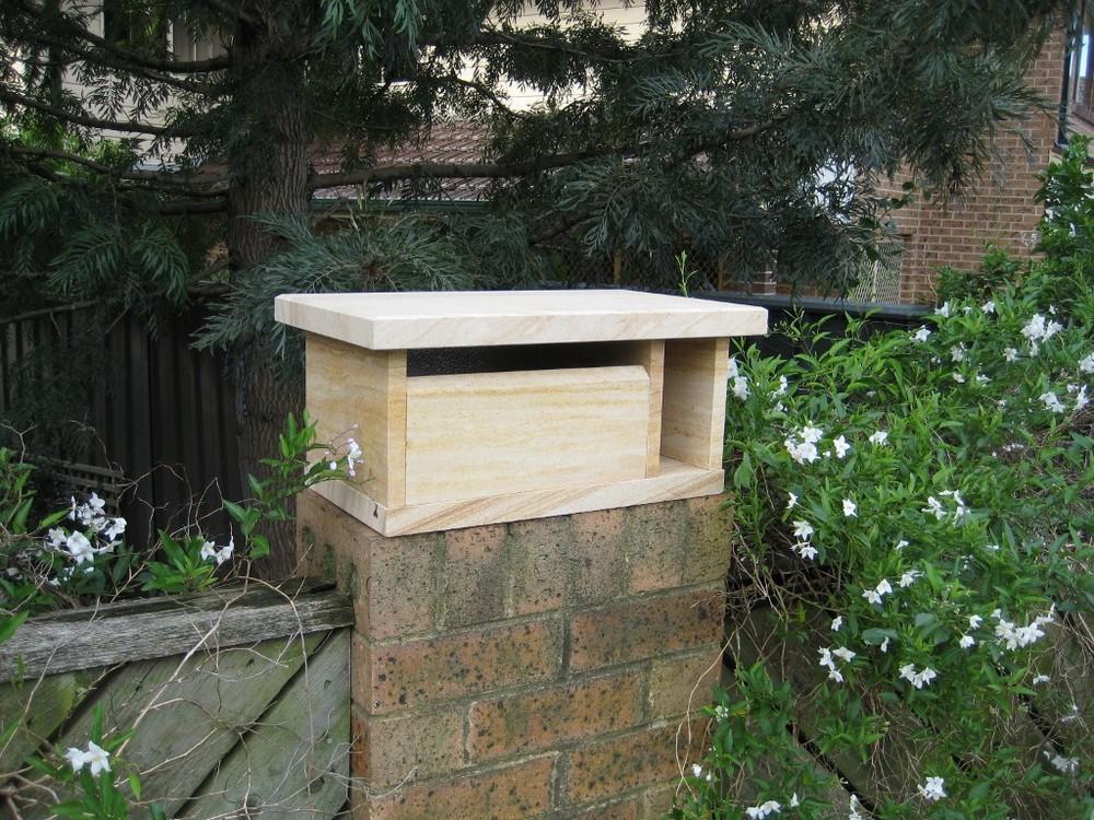 61. Sandstone, top only, for wall or pillar, 2 key aluminium back door $260