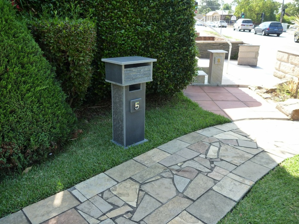64.  Bluestone solid, aluminium back door with 2 key lock 860cm high top part mesure 300mm x 400mm. $473