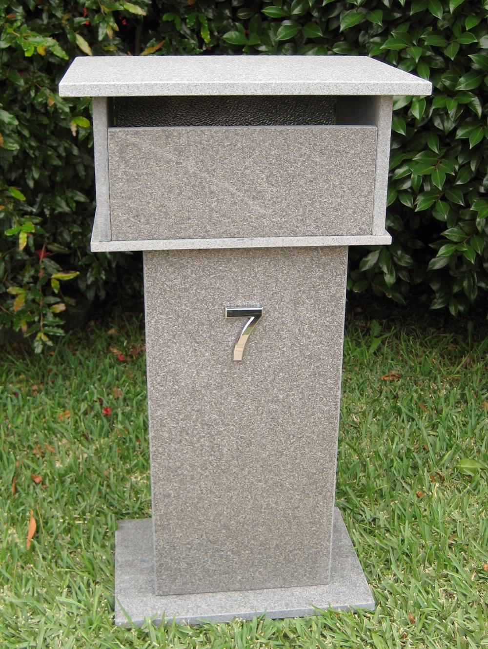 70. Blue stone letterbox with bushhammered finish. Back 2 key aluminium door. Tough material. Sizes 820x400x300 $430