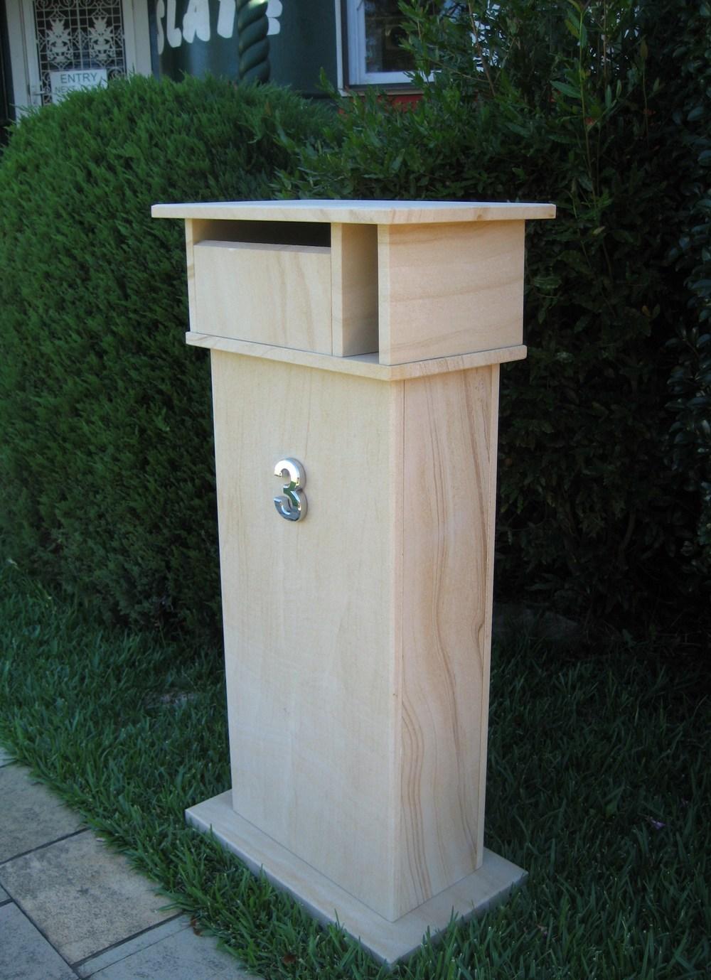 75. Extra tall letterbox, woodgrain sandstone. 1060 tall, dimentions 1060x400x300 $750