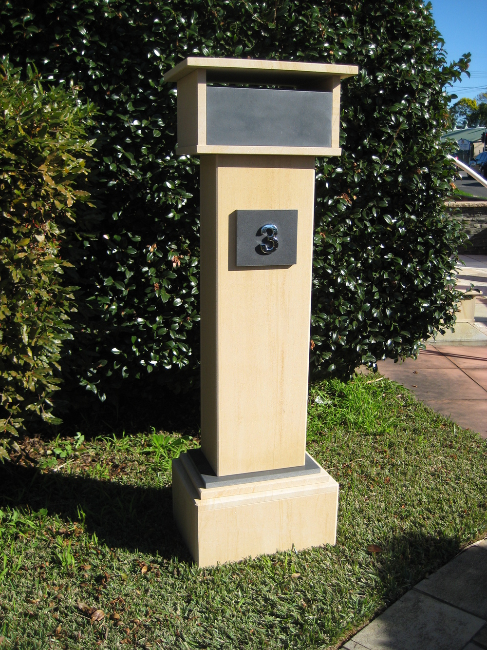 99. Extra tall letterbox, woodgrain sandstone. 1060 tall, dimentions 1250x400x300 $440