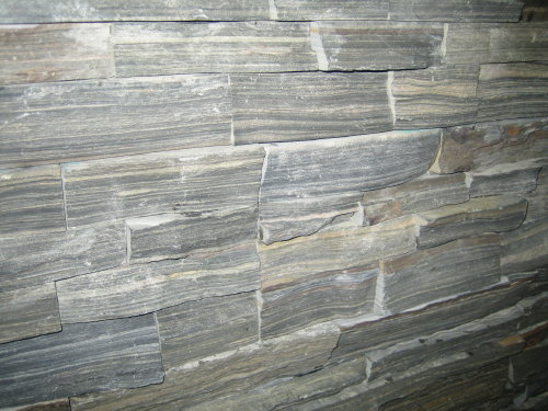 38. Gray hard side stacked stone.