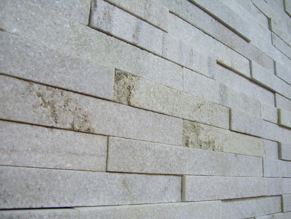 52. White crystallised quartzite stacked stone is extremely dense. Detail. Tiles 150x600mm.