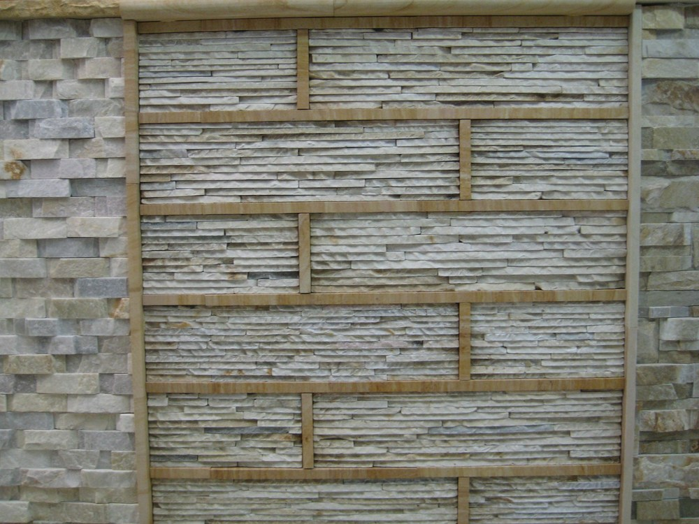63. Cream quartzite stacked stone trimmed with sandstone strips for special effect.