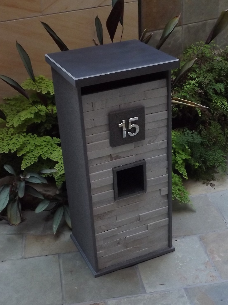 104a. Custom made Blue Stone mailbox with White quartzite front Size 850x400x350mm. Junk mail department under house number. Pick up from store only.  $720