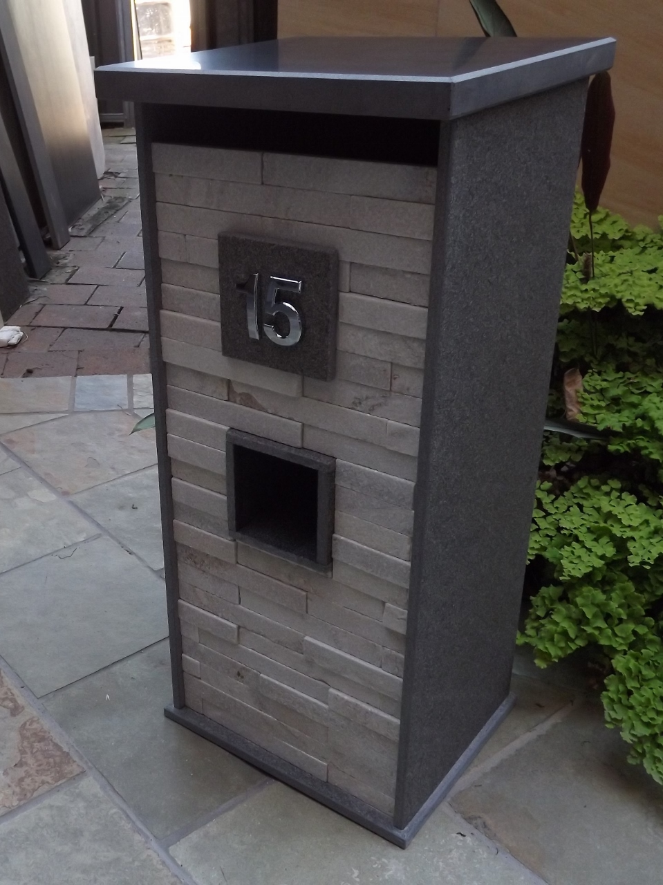 114b. Custom made Blue Stone mailbox with White quartzite front. Size outside  850x400x400mm. Junk mail department under house number. Pick up from store only. $990