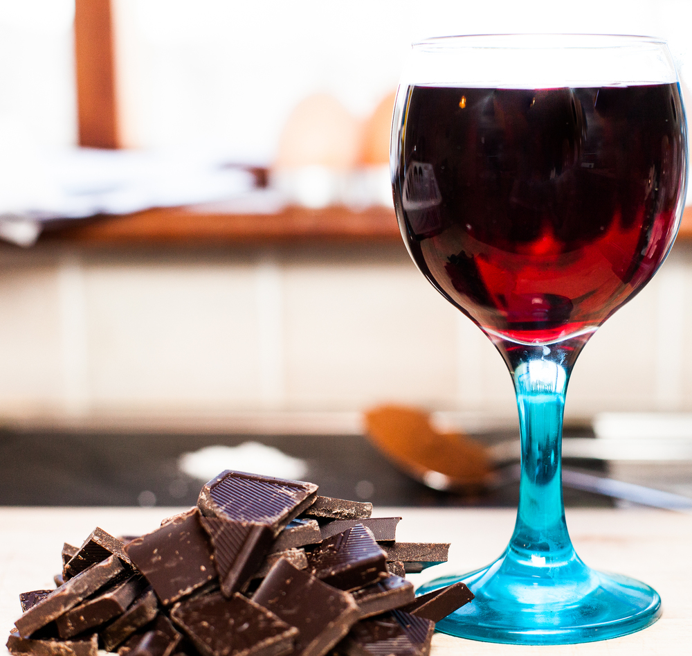 A glass of Red Wine - a must! ...and 100 g Chocolate minimum 75%, the darker the better!