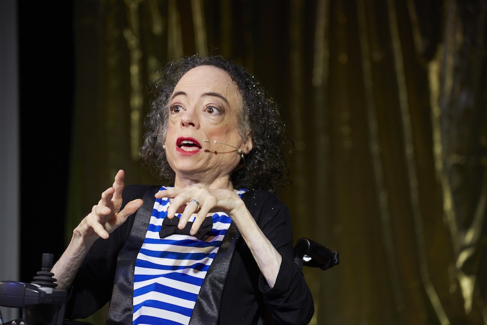 Liz Carr during Assisted Suicide: The Musical (and homepage) image by Manuel Vason **** 'A funny, in-yer-face, provocation of a show.' Scottish Herald 'It certainly made me rethink my position… It is very funny!' BBC Front Row 'An original, unprecedented piece of musical theatre.' Exeunt Magazine