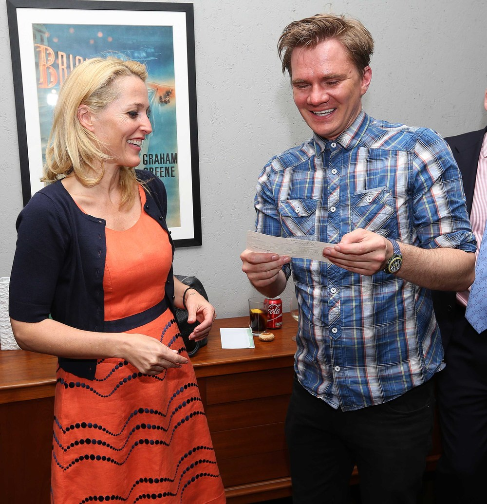 Oscar's Book Prize 2015 winner Steve Antony is presented with his prize cheque by prize judge Gillian Anderson