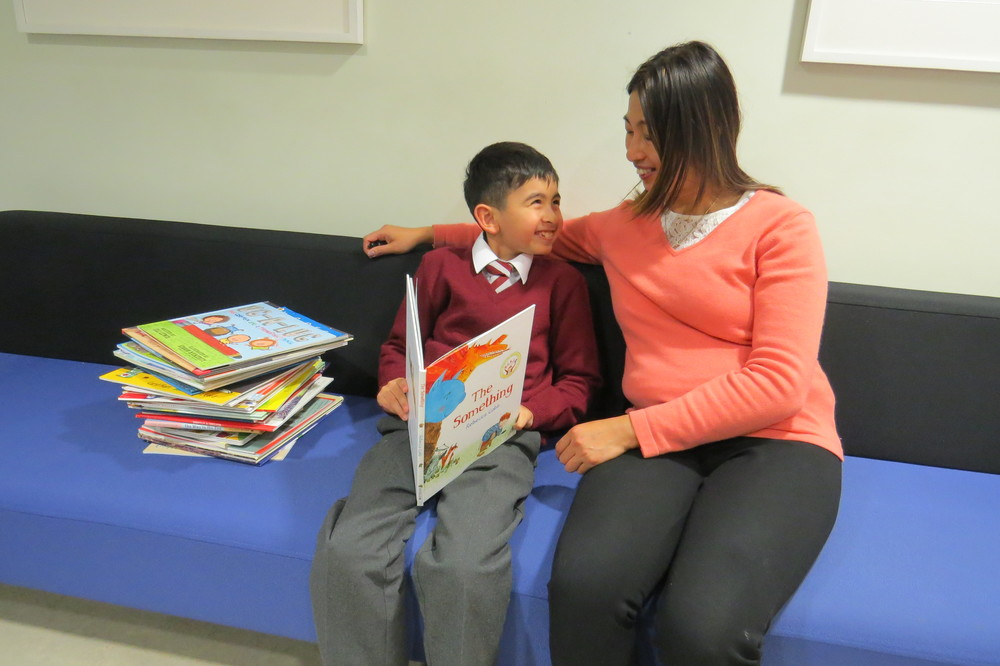 Young patient Luis Fafian and his mother Samorn Chimkeaw read one of the books donated to the Royal Brompton Hospital during an out-patient appointment in the inherited cardiac conditions clinic