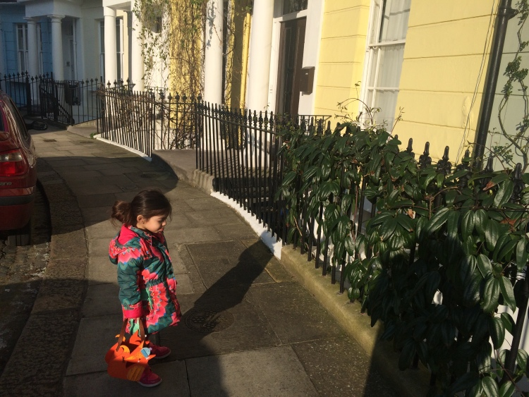 Gabriella stopping to look at the chocolate box house en-route to Chalcot Square
