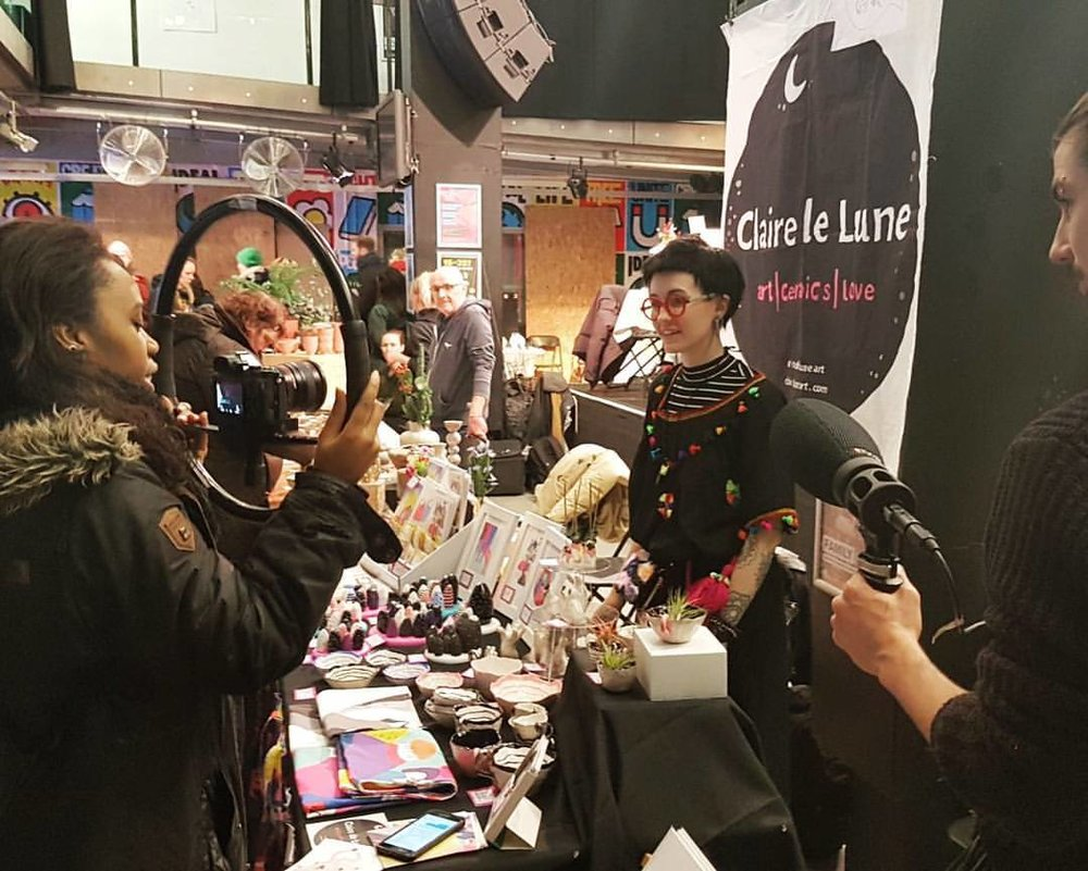 being interviewed at the Xmas market at Rich Mix London