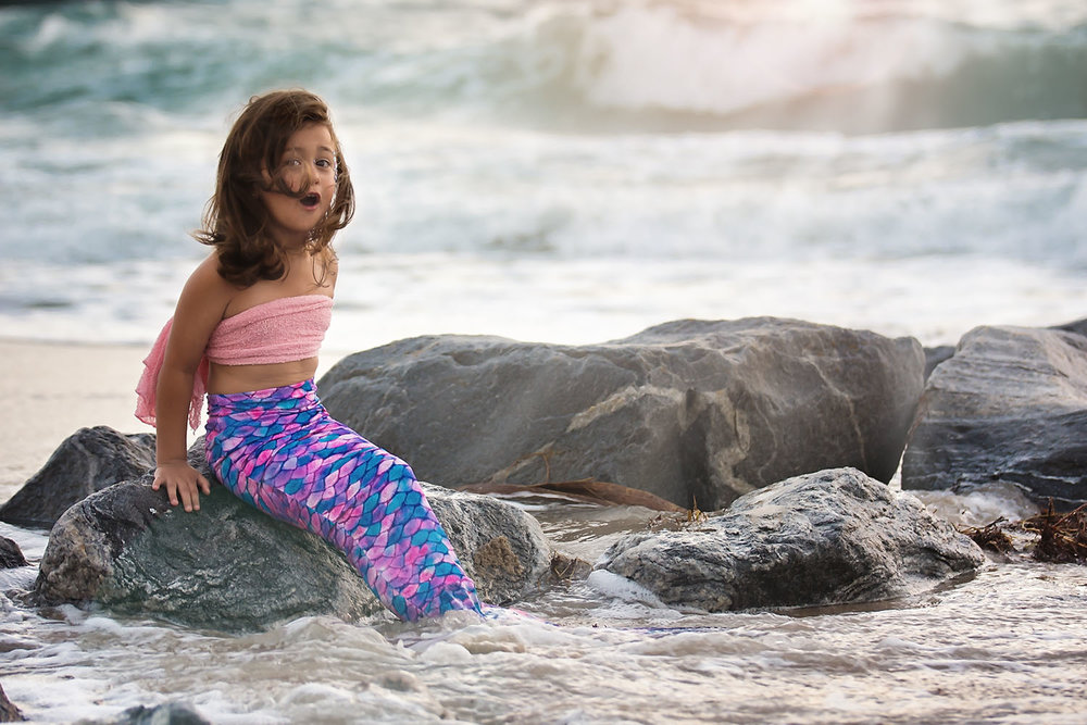 wellington-south-florida-beach-mermaid-photographer-magical-kids-portraits-photography-ocean-tail-pink-purple-splash-children-family-photo-rocks-waves-best-unique-kids.jpg
