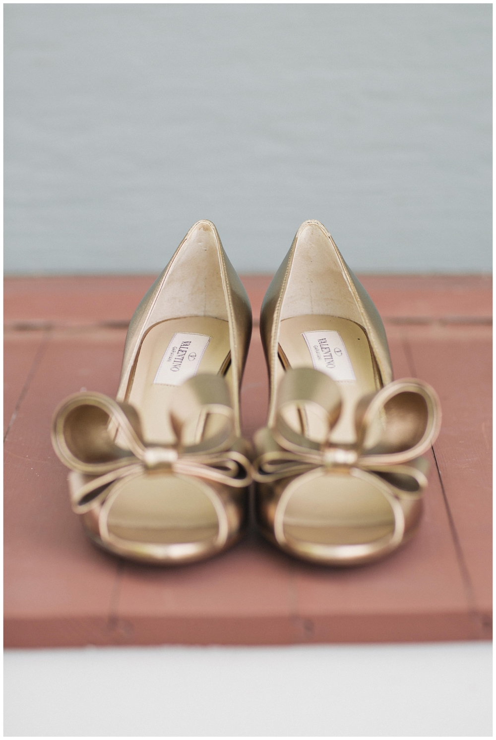 The Roxbury Barn Wedding Venue | Gold wedding shoes by Valentino | Barn Wedding