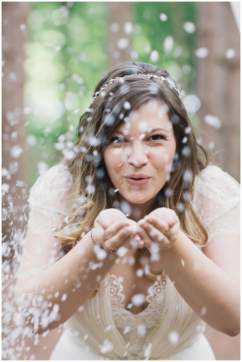 The Roxbury Barn Wedding Venue | Bride blowing confetti| Barn Wedding