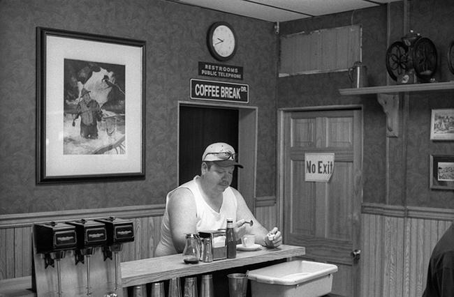 Man-at-counter.jpg