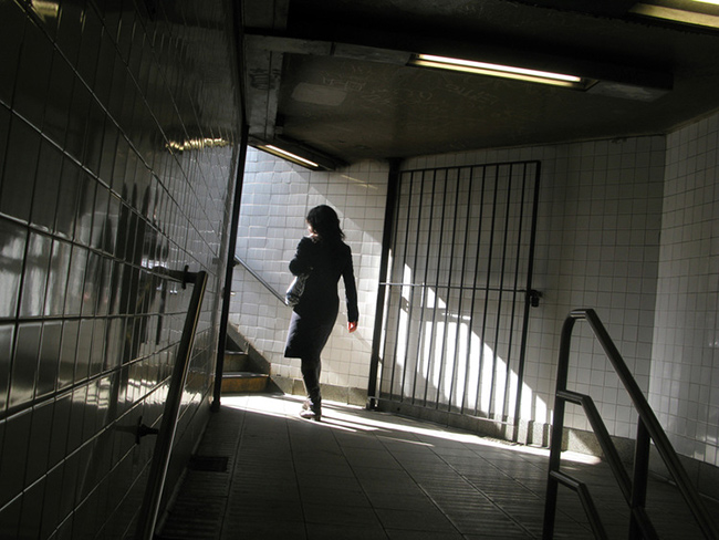 Woman-exiting-subway-station.jpg