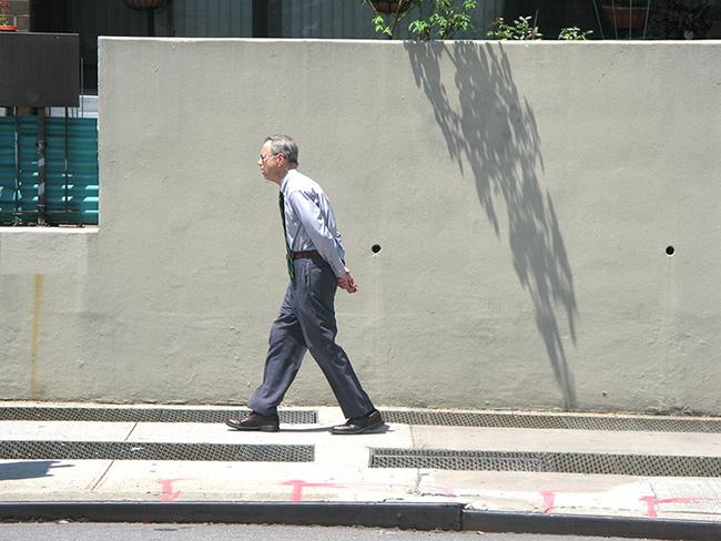 Man-walking-hands-behind-back.jpg