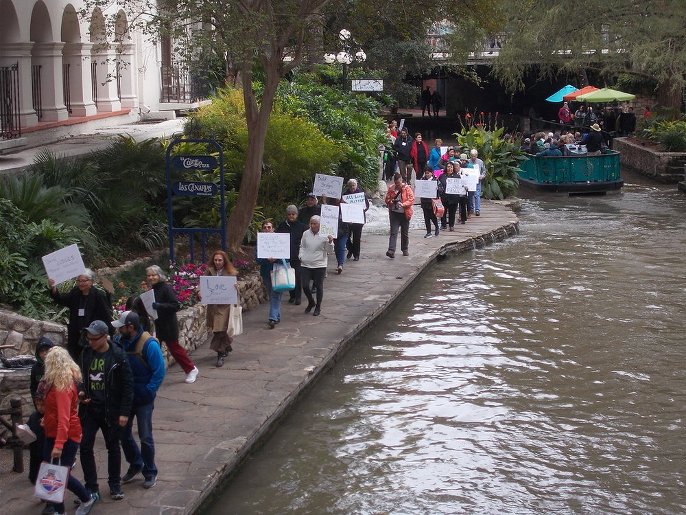 """Vigil Demonstration Supporting Immigration through San Antonio's """"River Walk"""" Business District"""