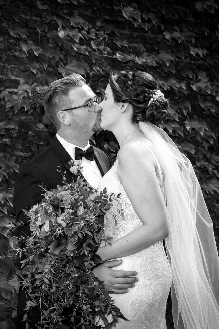 first_look_starline_factory_harvard_illinois_kiss_flowers