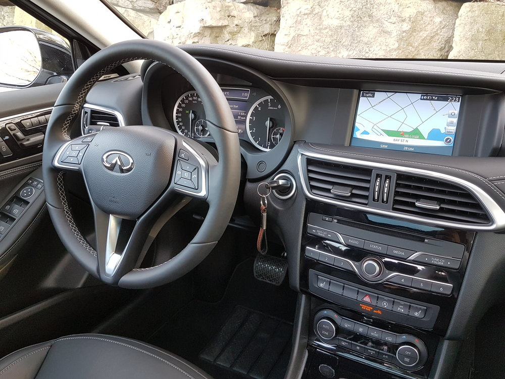 A nice mix of contrast-stitched black Nappa leather, piano black, and satin silver gives the cabin an upscale feel. The steering wheel and seat controls are straight out of a Mercedes, and they are great.