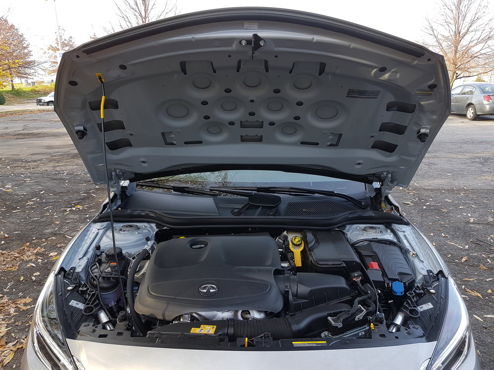 The 2.0T engine is brilliant and smooth, but this engine bay could use some sound dampening on the hood and gas struts to hold it up.
