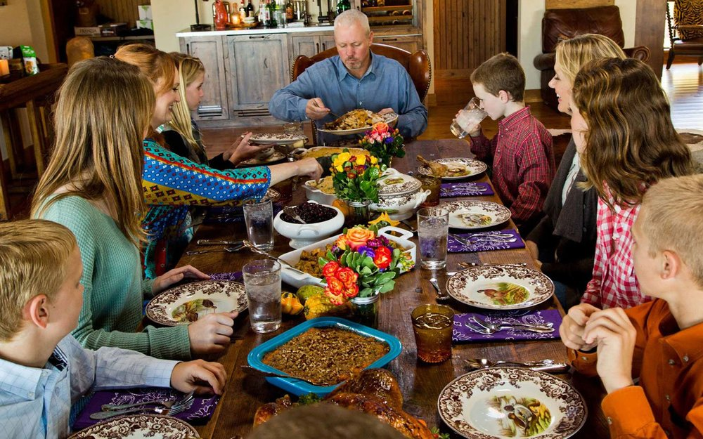 """Drummond family at thanksgiving dinner, with """"Marlboro Man"""" at the head of the table.Photo by Peter Frank Edwards for  Parade"""
