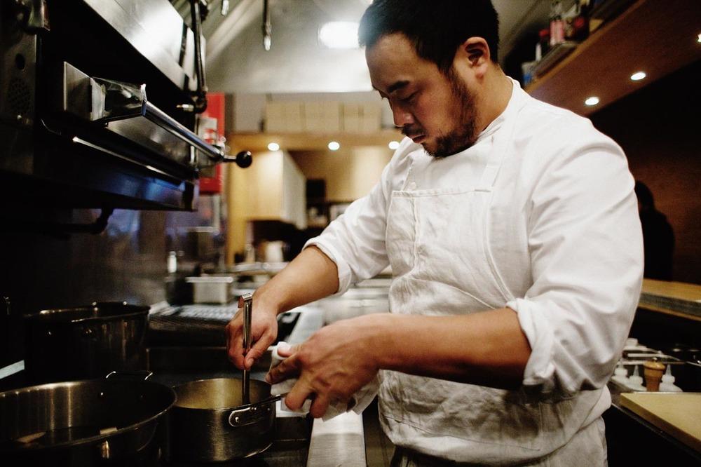 David Chang in the kitchen. From  Momofuku .
