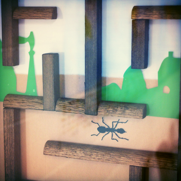 You'll have to tackle a giant ant farm in this escape room.