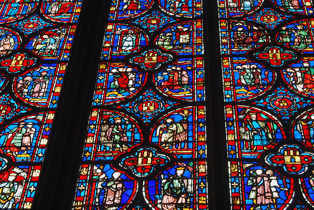 This photo of exquisite stained glass masterpiece is from the Sainte Chapelle in Paris, France. Color, different tonalities, and light create a surreal and magical show.