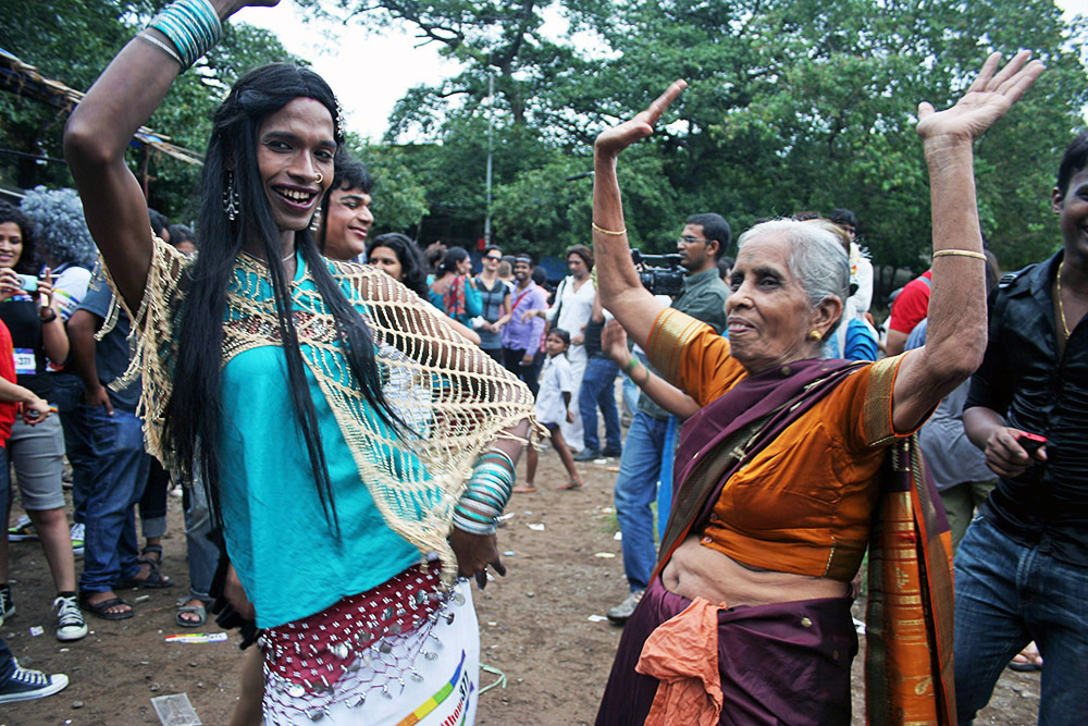 A transgender woman dances with an elderly lady at the Gay Pride Parade in Mumbai. Homosexuality and transsexuality has always been a topic of taboo in India. Now, transgenders are legally recognised as a third gender in Indian society.