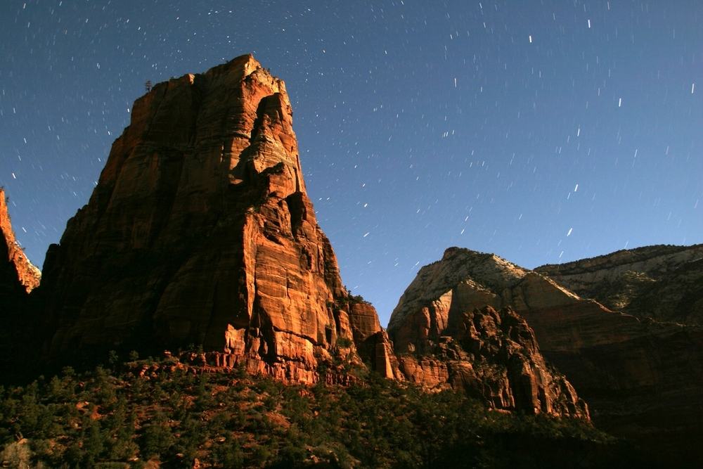 Star trails above Angels Landing lit by full moon, Zion National Park