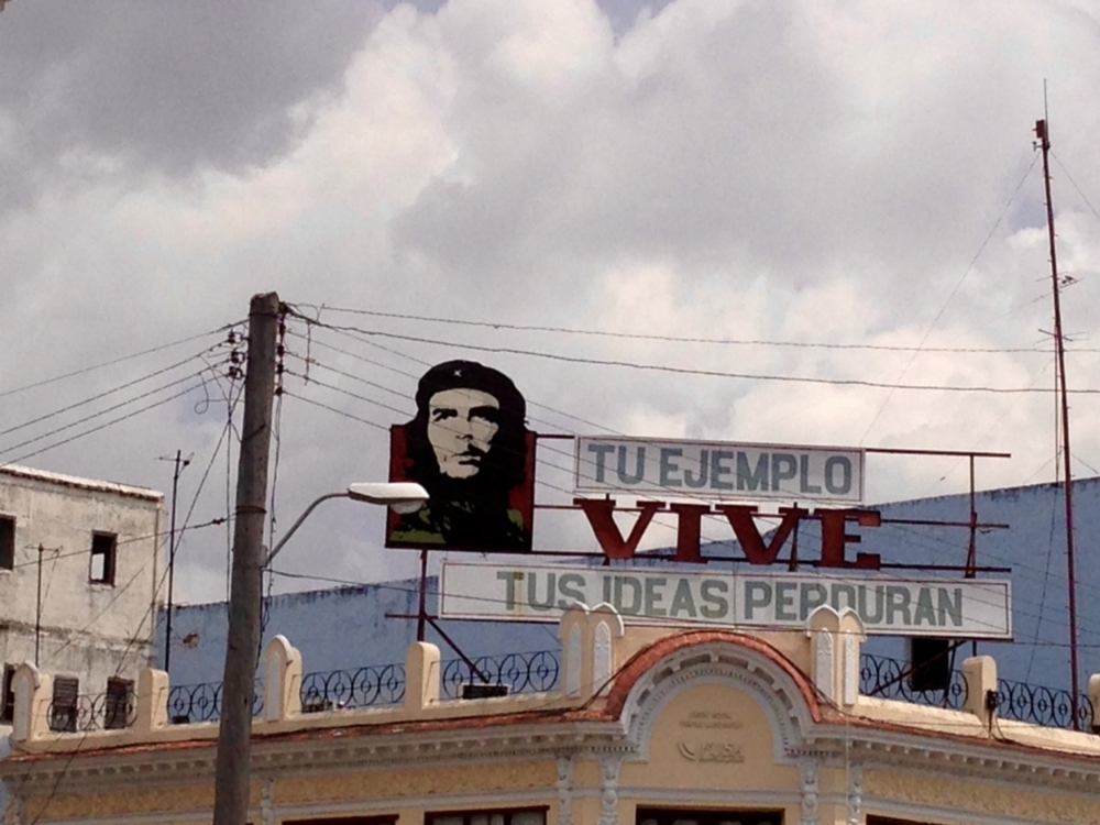 "Billboard in Cienfuegos depicting Che Guevara and the words, ""Your example lives, your ideas endure."