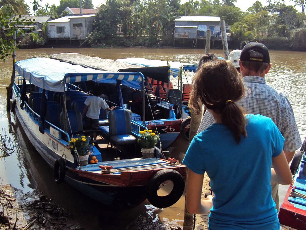 A canopy on the river boat keeps guests protected against the scorching South Vietnam sun.